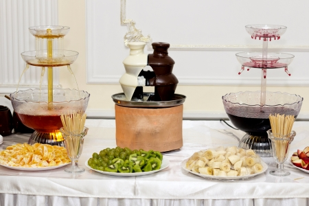 Furshetny desktop wine stage, hot white and black chocolate and fruit photo