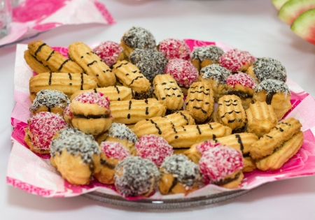 sweettooth: Cookies with a chocolate stuffing, nutlets, jam and coconut shaving
