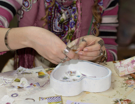 decoupage: Female hand with paper preparation for a decoupage
