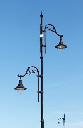 retro styled imagery: Retro Street Lamp against the blue sky Stock Photo