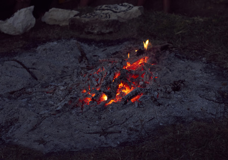 flare stack: Campfire from firewood and ashes outdoors