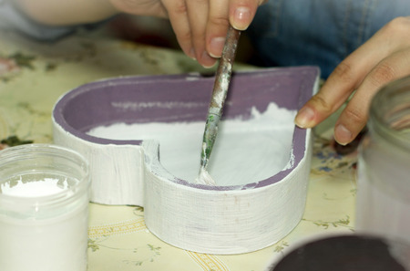 decoupage: Woman hand with a brush and glue for a decoupage