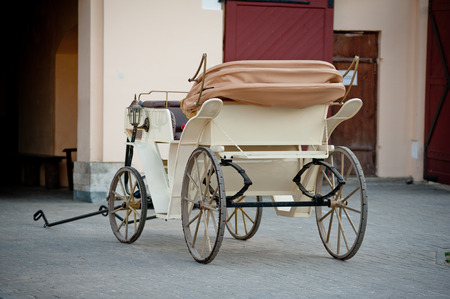 horse and carriage: horse carriage near stable Stock Photo