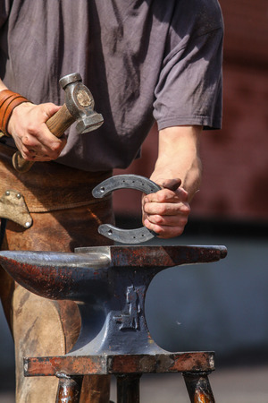 farrier: farrier making horseshoe