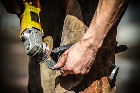 pinchers: Blacksmith making horseshoes