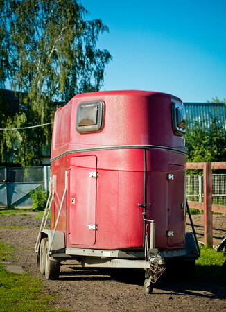trailer: horse transport on a territory of stables Stock Photo