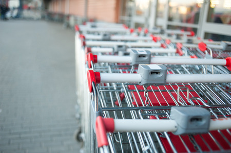 supermarket checkout: Closeup part of shopping carts stack near the shopping mall Stock Photo