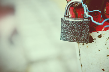 safeguards: photo of padlock hanging on barrier with the space for text