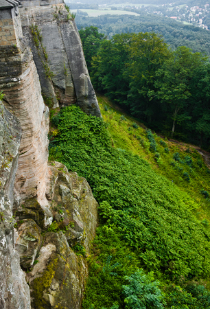 locating: View on a detail of konigstein fortress, locating in rocks and green forest