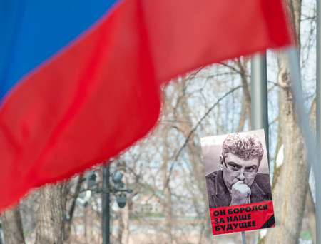 Moscow - Russia, February 25th - 2018, march devoted to memory of Boris Nemtsov Russian tricolor flag and transparent which says: He fighted for our future Editorial