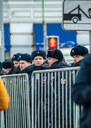 Moscow - Russia, February 25th 2018: police officers behind metallic fence, on the march of Boris Nemtsov,