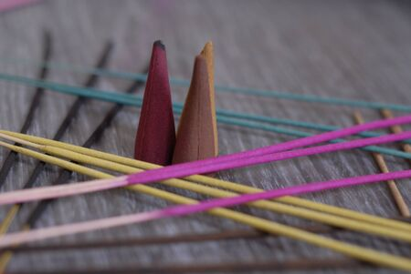 multicolored incense sticks, and cones