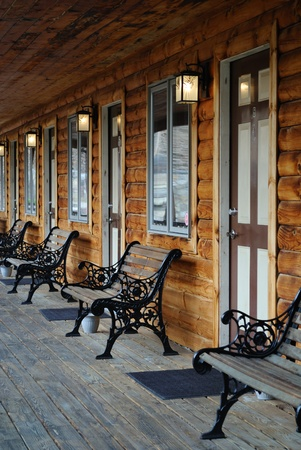 Exterior patio of a log cabin motel photo