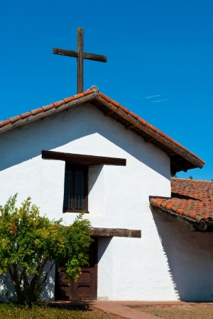 Spanish style church with rustic wooden cross Stock Photo - 14474816