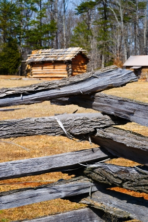 Wooden Log Fence Surrounding a Cabin