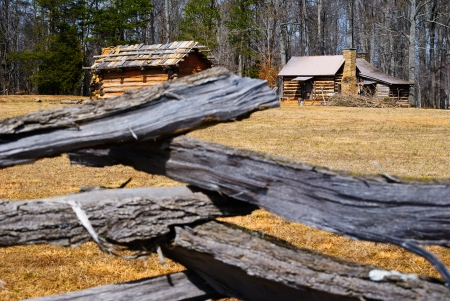 Wooden Log Fence Surrounding a Cabin Stock Photo - 23343213