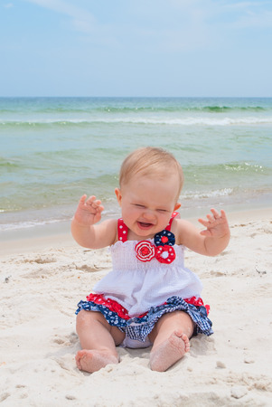 July 4th Patriotic Baby Girl at the Beach Reklamní fotografie
