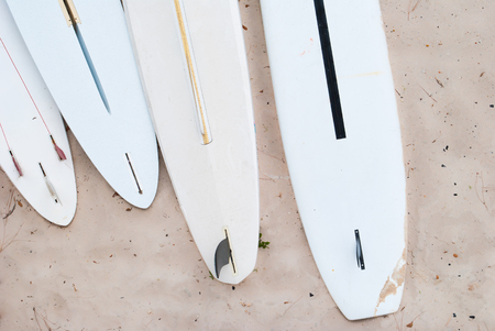 surfboard fin: Aerial View of Surfboards in the Sand