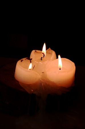 esoterics: Three candle flame on black background symbol religion