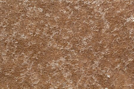 Natural white salt crystal texture on the sand, macro, close up. Salty lake shore background, Spain, Torrevieja.