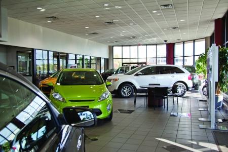 auto dealership: New Car Dealer auto showroom Editorial