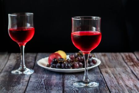 Pink wine. Wine in a glass. Traditional Georgian wine according to ancient technology. Copy space Close-up and horizontal orientation.