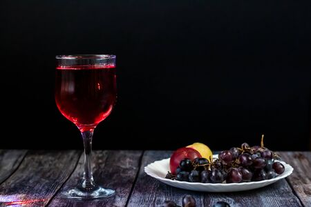 Pink wine. Wine in a glass. Traditional Georgian wine according to ancient technology. Close up and horizontal orientation.