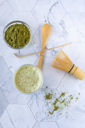 Matcha green latte tea with coconut milk. This latte is a tasty way to enjoy the energy and health benefits of a match. Matcha is a green tea leaf powder filled with antioxidants.