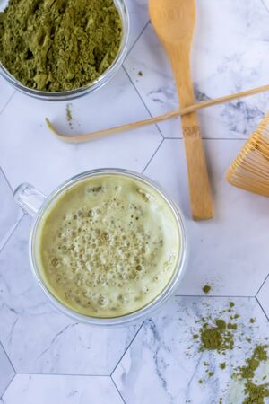 Matcha green latte tea with coconut milk. This latte is a tasty way to enjoy the energy and health benefits of a match. Matcha is a green tea leaf powder filled with antioxidants. Vertical orientation