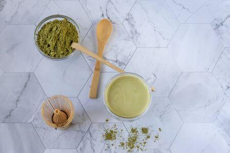 Matcha green tea is a delicious way to enjoy energy and health benefits. Matcha is a green tea leaf powder filled with antioxidants. Horizontal orientation Reklamní fotografie