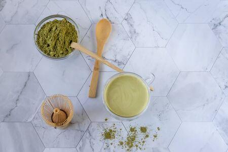Matcha green tea is a delicious way to enjoy energy and health benefits. Matcha is a green tea leaf powder filled with antioxidants. Horizontal orientation Фото со стока