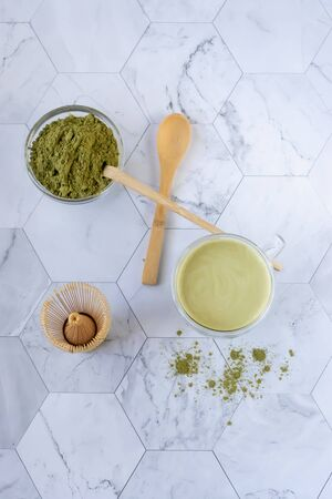 Matcha green tea is a delicious way to enjoy energy and health benefits. Matcha is a green tea leaf powder filled with antioxidants. Vertical orientation Фото со стока