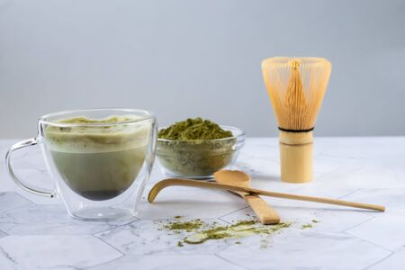 Matcha green latte tea with coconut milk. This latte is a tasty way to enjoy the energy and health benefits of a match. Matcha is a green tea leaf powder filled with antioxidants. Horizontal orientation