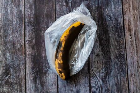Spoiled banana in a plastic bag. Storage leads to spoilage of products, pollutes the environment