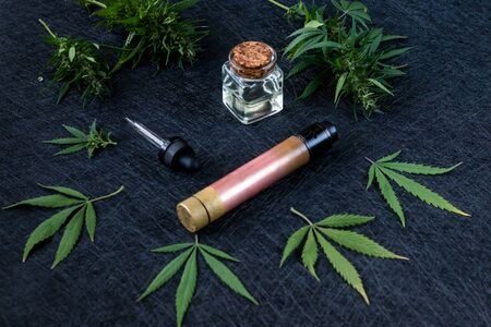Vape CBD or THC, Vaping Marijuana and Hemp. Against a Dark Background. Horizontal orientation