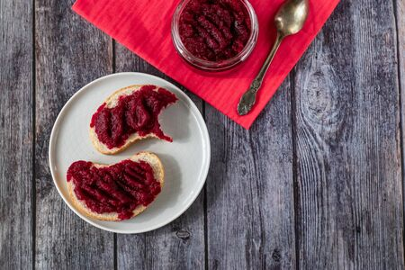 Sandwiches with natural homemade beetroot jam, with vanilla and sugar. Healthy food, vegetarianism.