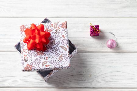 Holiday gift box on a white wooden background. with christmas decorations