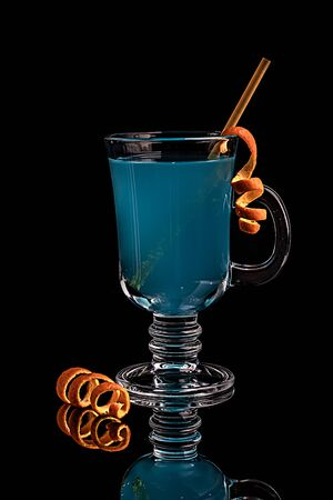 Blue cocktail, carbonated refreshing drink. Blue lagoon on a black background 写真素材