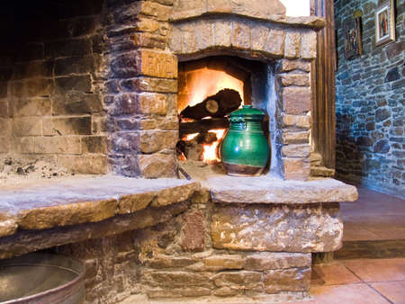 Picture of cosy fireplace and green pot