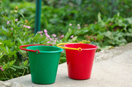 Picture of gardening pail, red and green