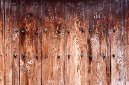 defects: Vertically stacked old boards with rusty nails