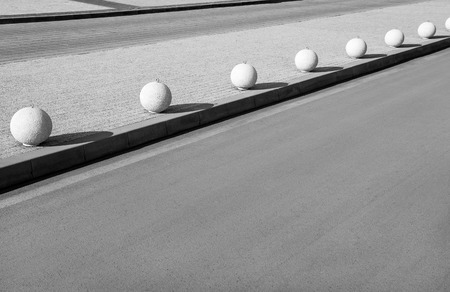 separator: Urban infrastructure. Surge motion on the sidewalk spherical shape. The separator of the sidewalk and the roadway Stock Photo