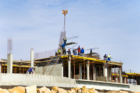 hotel resort: The construction of the hotel on the Black Sea. A team of builders Stock Photo