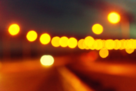 Blurred background with lights of the city at night. Big city bridge. Bokeh basic background for design Stock Photo