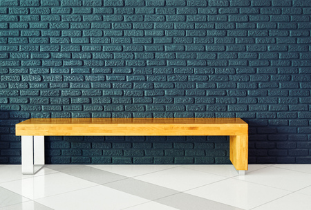 greece granite: Rectangular wooden bench on a background of gray brick wall in the lobby of a large modern shopping mall. Basic background for design Stock Photo