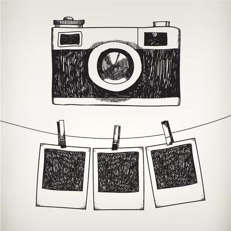 Macchina fotografica: Vector mano Doodle disegnato illustrazione di cornici retrò e macchina fotografica. Hanging foto in uno studio fotografico.