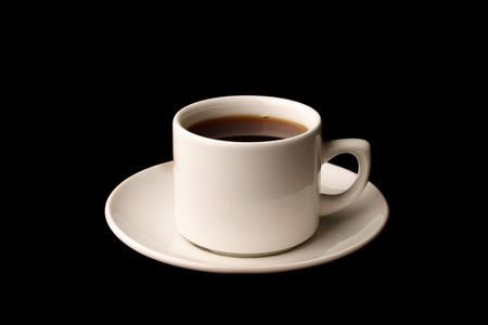 Cup of tea isolated over black background photo