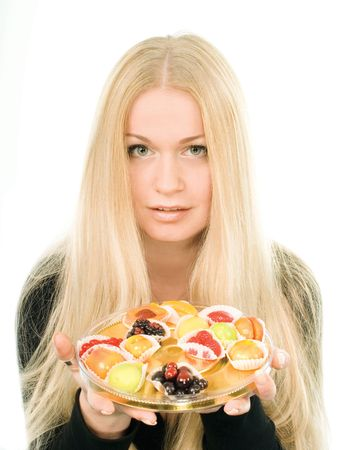 Attractive young woman with fruit candies over white background Stock Photo - 2426267