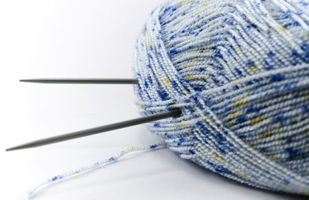 Blue wool and needles over white photo