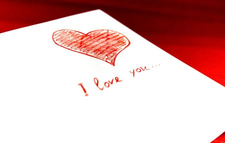 white envelope with red heart on red background photo